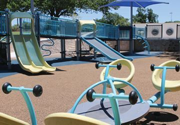 central park playground with slide and two platforms
