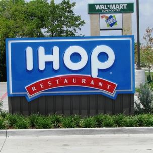 IHOP Restaurant Sign with Walmart Supercenter and Sams Club Sign in the Background